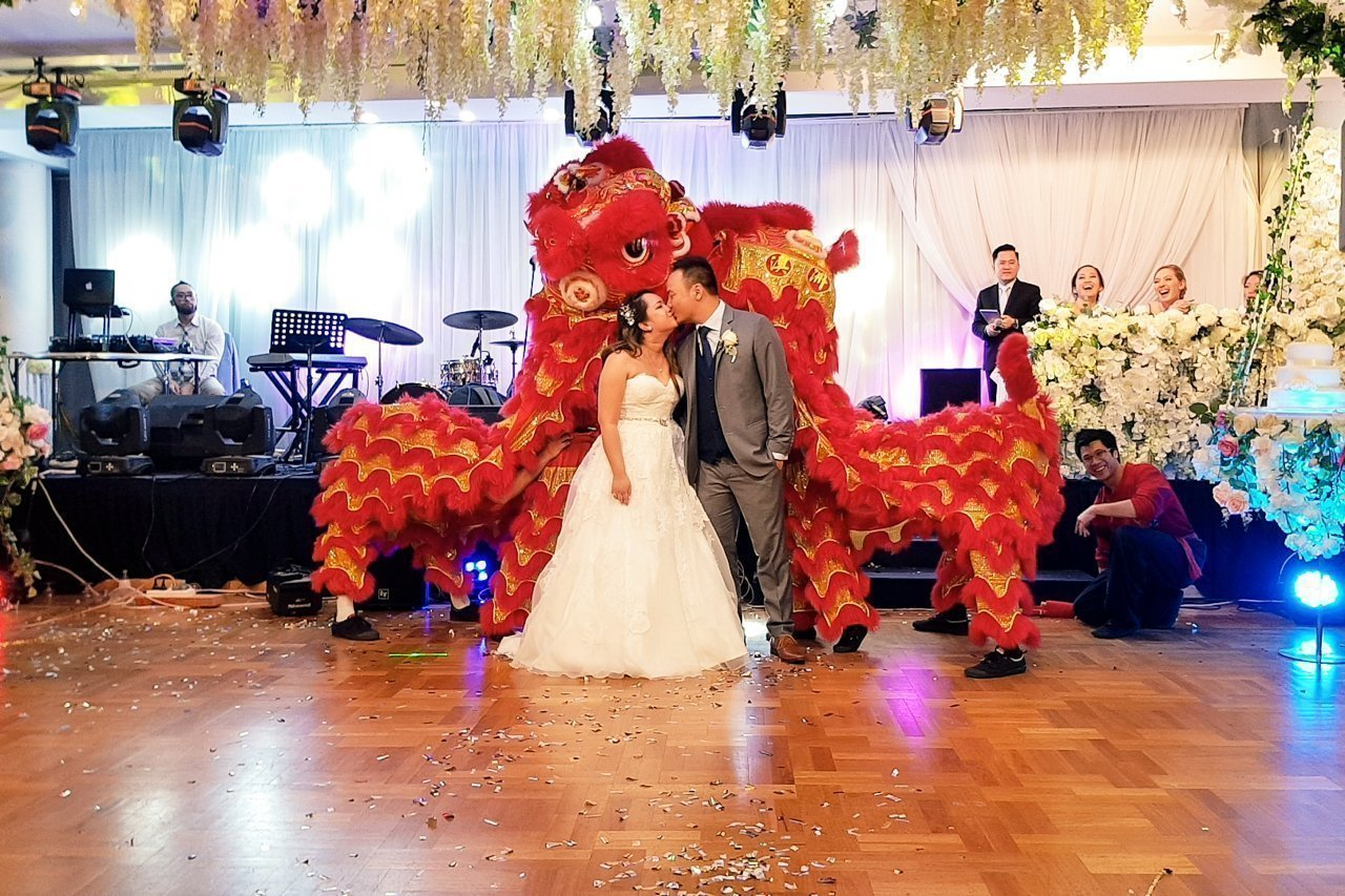 Wedding lions kissing with bridge & groom