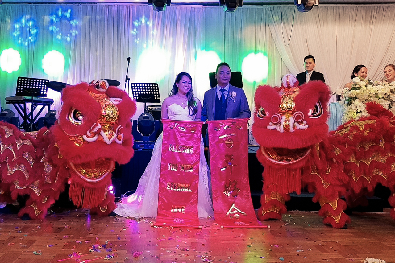 Wedding lions posing with bride & groom