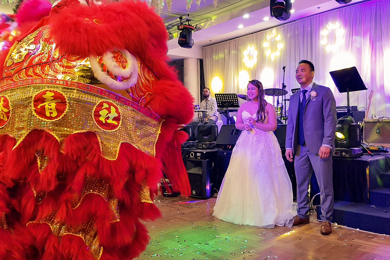 Wedding lions entertaining the bride & groom